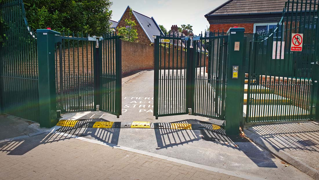 Bi-folding automated gates